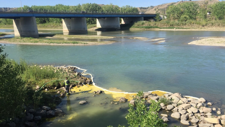 City crew have contained a spill, believed to be cooking oil, in the Oldman River that was discovered on Tuesday.
