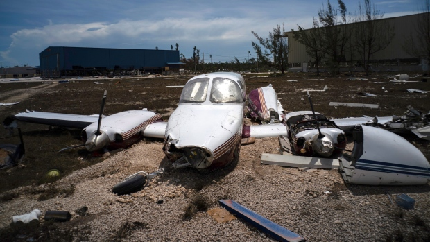 A plane destroyed by Hurricane Dorian sits amid debris at the airport in Freeport, Bahamas, Wednesday, Sept. 4, 2019. Rescuers trying to reach drenched and stunned victims in the Bahamas fanned out across a blasted landscape of smashed and flooded homes Wednesday, while disaster relief organizations rushed to bring in food and medicine. (AP Photo/Ramon Espinosa)