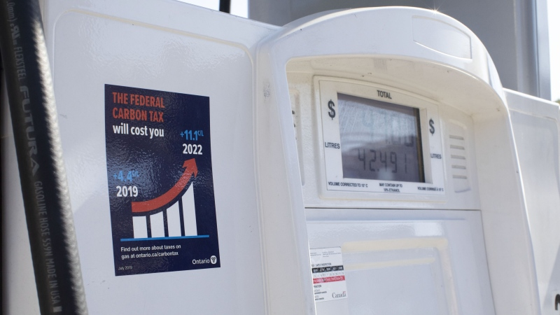 A gas pump displays an anti-carbon tax sticker in Toronto on Thursday, August 29, 2019. A civil rights group is asking the courts to declare an Ontario law mandating anti-carbon tax stickers on gas pumps to be illegal. THE CANADIAN PRESS/Chris Young