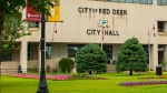 A man was found injured on the steps of Red Deer City Hall.