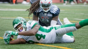 Saskatchewan Roughriders' Jordan Williams-Lambert reaches in for a touchdown as Montreal Alouettes' Dominique Ellis looks on during second half CFL action in Montreal on Saturday, Sept. 30, 2018. THE CANADIAN PRESS/Peter McCabe