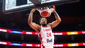 Canada's Khem Birch scores a basket against Senegal during their group H match in the FIBA Basketball World Cup 2019 game in Dongguan in south China's Guangdong province, Thursday, Sept. 5, 2019. (AP Photo)