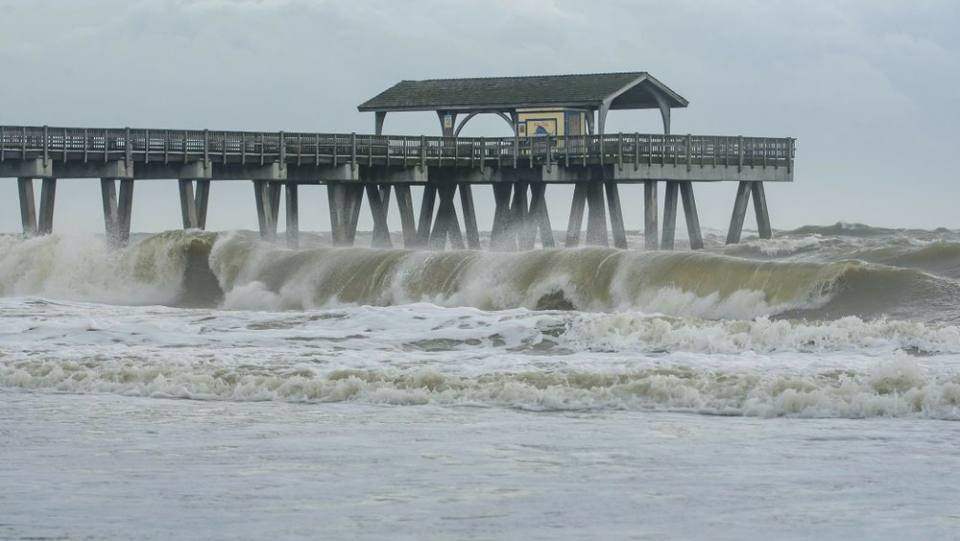Large waves crashed onto the beach of Tybee Island, Ga., Wednesday, Sept. 4, 2019 as Hurricane Dorian moved closer to the Georgia coast. (Casey Jones/Savannah Morning News via AP)