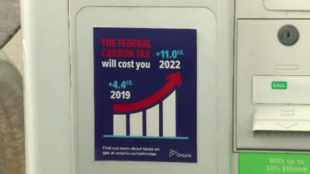 carbon tax gas station sticker