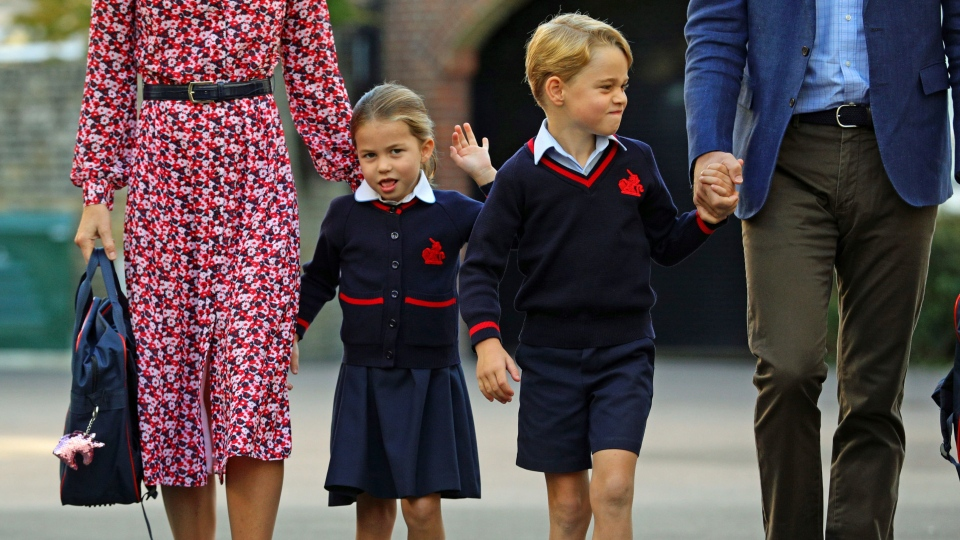 Princess Charlotte, left, with her brother Prince George and their parents Prince William and Kate, Duchess of Cambridge, arrives for her first day of school at Thomas's Battersea in London, Thursday Sept. 5, 2019. (Aaron Chown/Pool via AP)