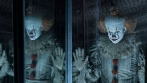 Pennywise the Dancing Clown can be seen in a mirror room in this scene from 'It: Chapter Two.' (Warner Bros. Pictures)