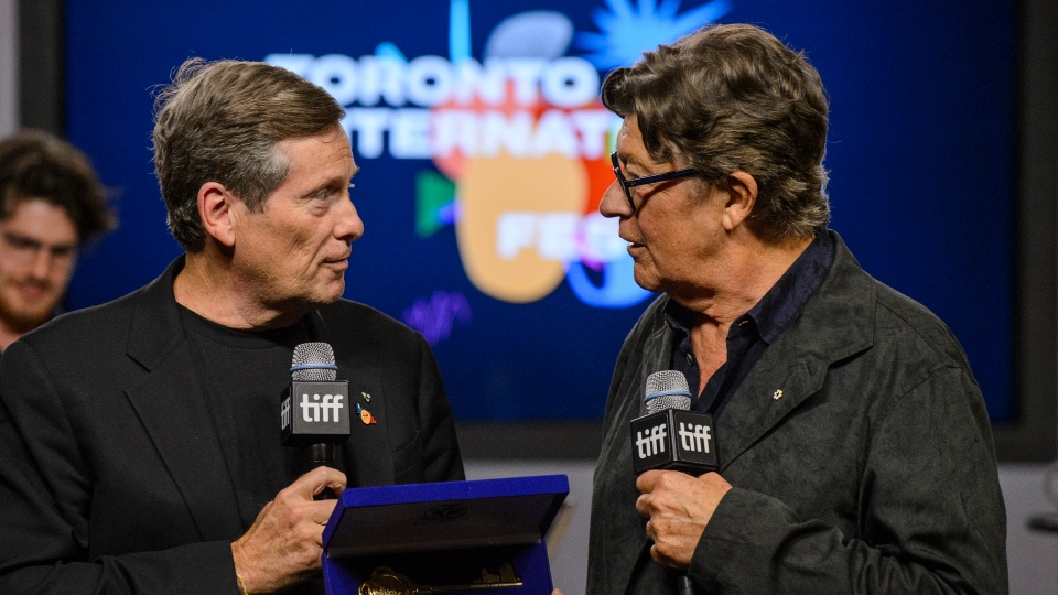 "Toronto Mayor John Tory, left, presents Robbie Robertson with a key to the city during a press conference to promote the movie ""Once Were Brothers: Robbie Robertson and The Band"" during the 2019 Toronto International Film Festival in Toronto., on Thursday, Sept. 5, 2019. THE CANADIAN PRESS/Andrew Lahodynskyj"