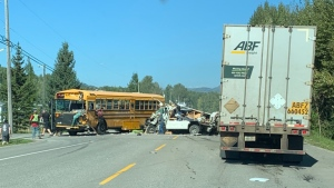 1 airlifted to hospital after crash involving school bus