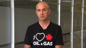 "William Lacey, of Calgary, talks to CTV News while wearing his ""I love Canadian oil and gas"" shirt."