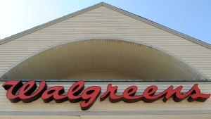 FILE - This Sept. 28, 2009, file photo, shows a sign above a Walgreens entrance in Gloucester, Mass. (AP Photo/Lisa Poole, File)
