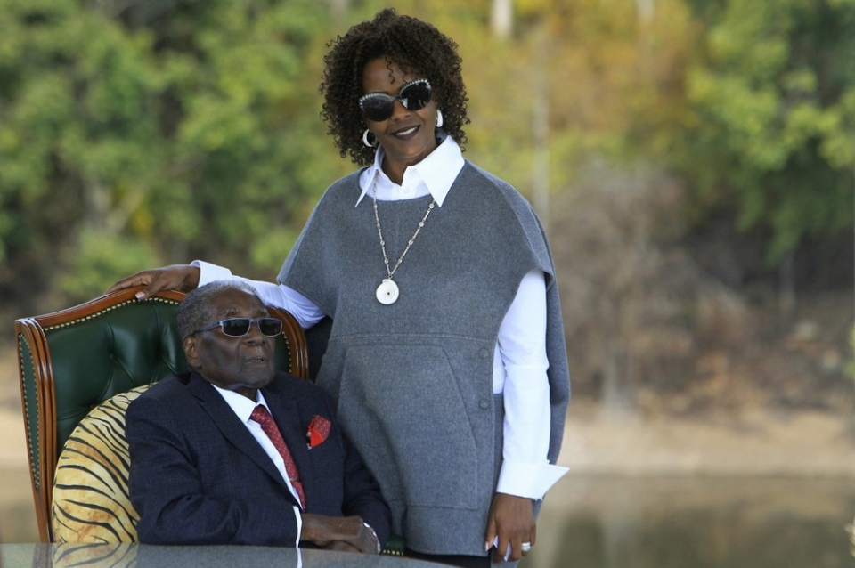 FILE - In this Sunday, July, 29, 2018, file photo, Former Zimbabwean President Robert Mugabe, left, and his wife Grace pose for a photo after a press conference at their residence in Harare. (AP Photo/Tsvangirayi Mukwazhi, File)