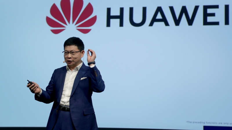 Richard Yu, CEO of the Huawei consumer business group, holds a 'Kirin 990 5G' processor during a keynote at the IFA 2019 tech fair in Berlin, Germany, Friday, Sept. 6, 2019. (AP Photo/Michael Sohn)