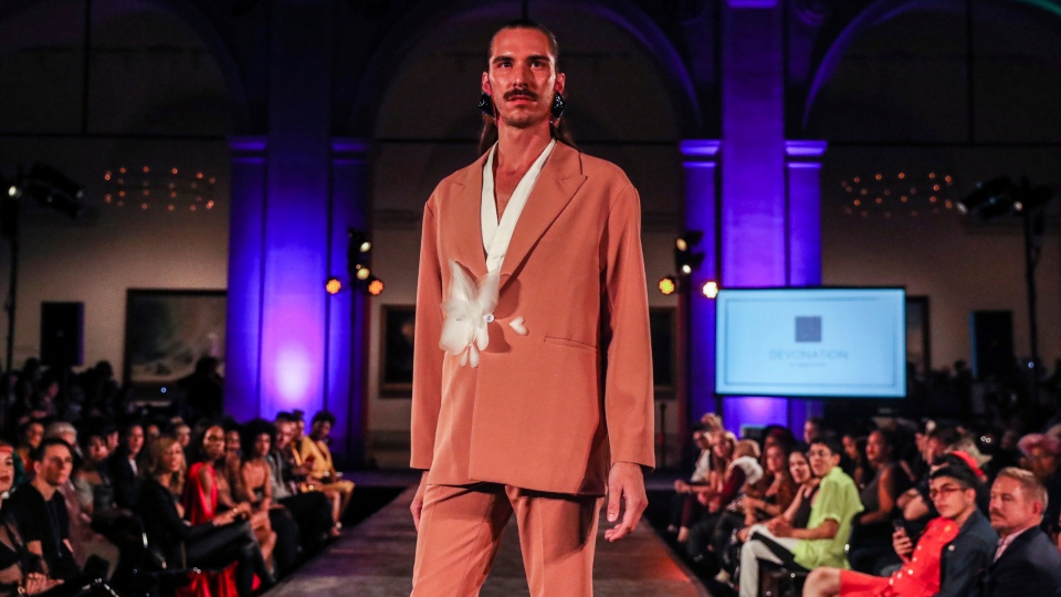The Devonation by Devon Yan collection is modeled during dapperQ fashion show at the Brooklyn Museum Thursday, Sept. 5, 2019, in New York. (AP Photo/ Jeenah Moon)