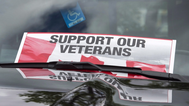 A sign is placed on a truck windshield as members of the advocacy group Banished Veterans protest outside the Veterans Affairs office in Halifax on Thursday, June 16, 2016. THE CANADIAN PRESS/Andrew Vaughan