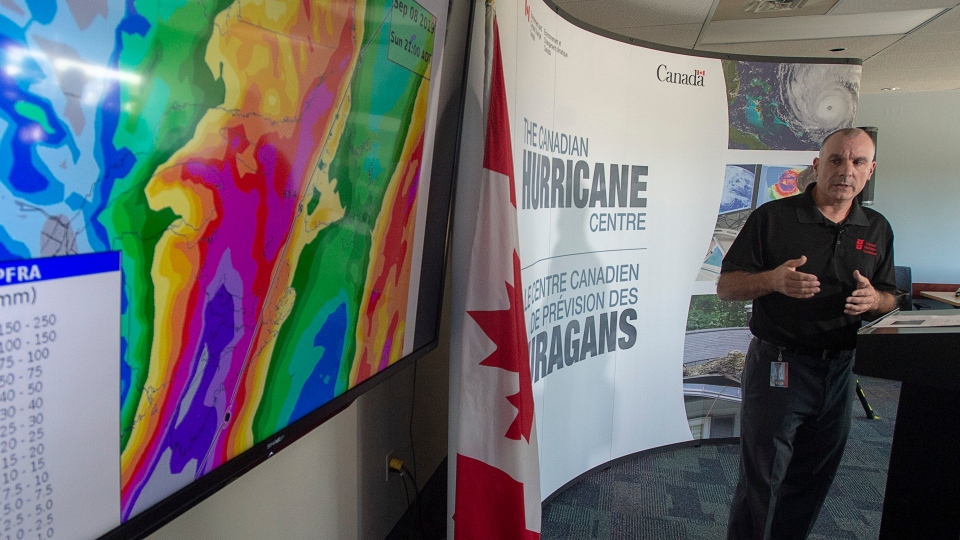 Meteorologist Bob Robichaud of the Canadian Hurricane Centre provides an update on Hurricane Dorian in Dartmouth, N.S. on Friday, Sept. 6, 2019. The major storm is expected to hit Nova Scotia on Saturday. THE CANADIAN PRESS/Andrew Vaughan