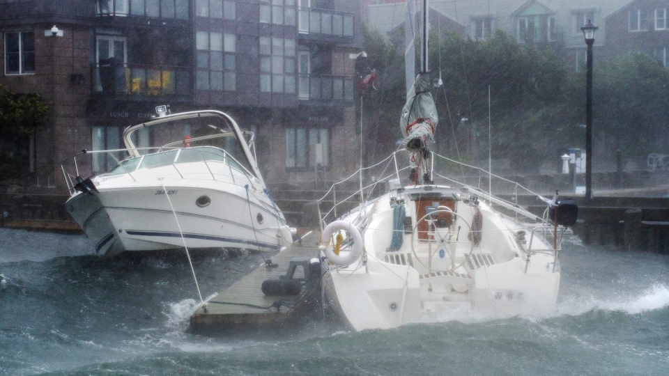 Pleasure boats take a beating along the waterfront in Halifax as hurricane Dorian approaches on Saturday, Sept. 7, 2019. (THE CANADIAN PRESS/Andrew Vaughan)