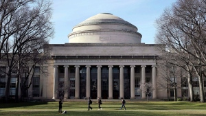 "In this April 3, 2017 file photo, students walk past the ""Great Dome"" atop Building 10 on the Massachusetts Institute of Technology campus in Cambridge, Mass. Two prominent researchers quit MIT's Media Lab over revelations that the famed technology research hub and its director took money from Jeffrey Epstein after he'd served time for sex offenses involving girls and young women. Ethan Zuckerman, director of the lab's Center for Civic Media, said director Joi Ito had failed to disclose the deceased financier's funding of the Massachusetts Institute of Technology incubator as well as investments Epstein made in Ito's personal venture capital fund, Wednesday, Aug. 21, 2019. Ito has now resigned. (AP Photo/Charles Krupa, File)"