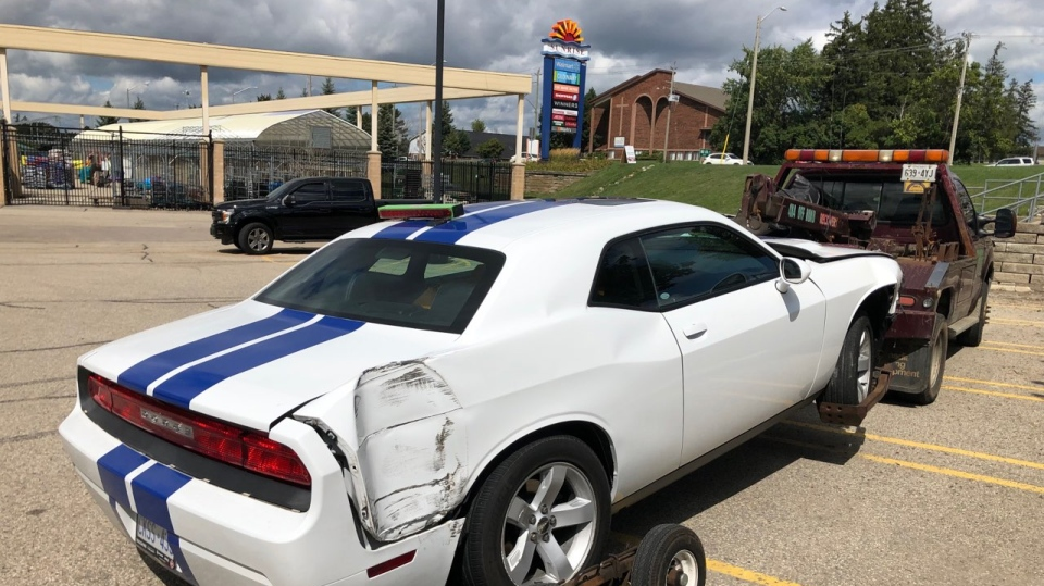 A vehicle that reportedly crashed into a transport truck on Hwy. 7/8 in Kitchener after street racing. (Twitter: Sgt. Kerry Schmidt OPP) (Sept. 7, 2019)