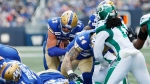 Winnipeg Blue Bombers quarterback Chris Streveler (17) crosses the line for the touchdown against the Saskatchewan Roughriders during the first half of CFL action in Winnipeg Saturday, September 7, 2019. THE CANADIAN PRESS/John Woods