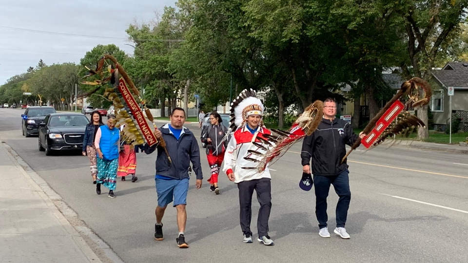 Walkers trek from the Regina Indian Industrial School Cemetery, to help transport the spirits of the children that lost their lives at the school. (Colton Wiens/CTV News)