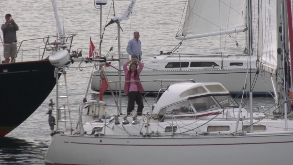 On Saturday afternoon, Jeanne Socrates arrived back home just after 4:15 p.m. to people cheering her on as she celebrated on her boat. (CTV Vancouver Island)