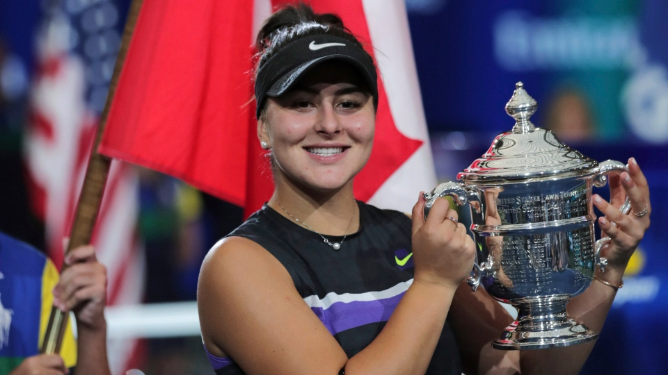 Bianca Andreescu, of Canada, poses with the championship trophy after defeating Serena Williams, of the United States, in the women's singles final of the U.S. Open tennis championships Saturday, Sept. 7, 2019, in New York. (AP Photo/Charles Krupa)