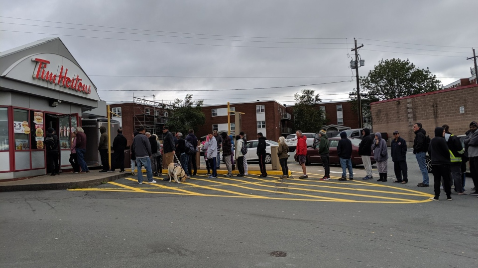 People line up for coffee at the Tim Hortons on Wyse Road in Dartmouth on Sept. 8, 2019. It was one of the few locations opened after Dorian swept through the region.