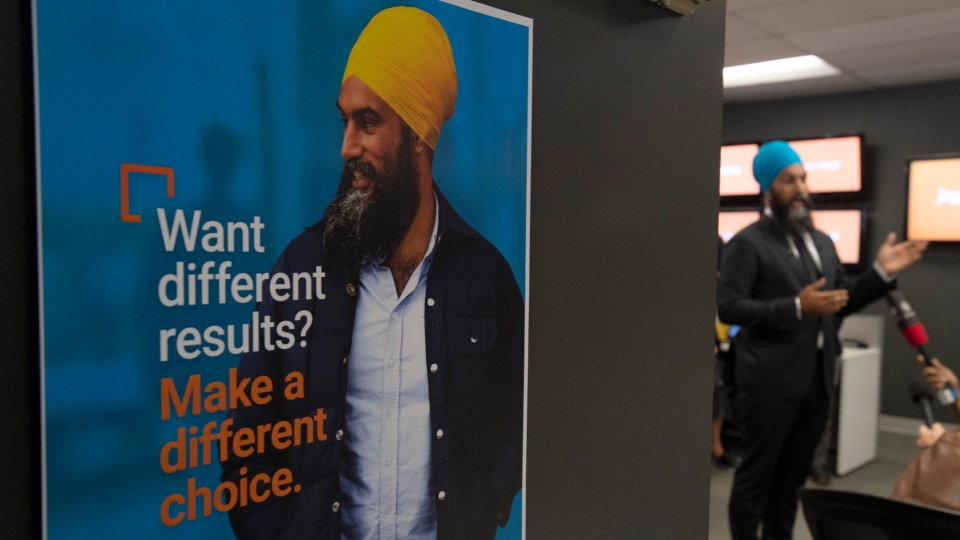 A poster of NDP leader Jagmeet Singh hangs on the wall as he speaks to party members at NDP head quarters in Ottawa, Saturday September 7, 2019. THE CANADIAN PRESS/Adrian Wyld