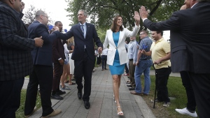 Manitoba Premier Brian Pallister and his wife Esther walk through supporters as he heads to announce that the writ has been dropped and he is calling a September election in Winnipeg Monday, August 12, 2019. THE CANADIAN PRESS/John Woods