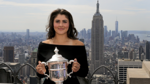 Bianca Andreescu poses with the US Open women's singles championship trophy at Top of the Rock, Sunday, Sept. 8, 2019, in New York. (AP Photo/Charles Krupa)