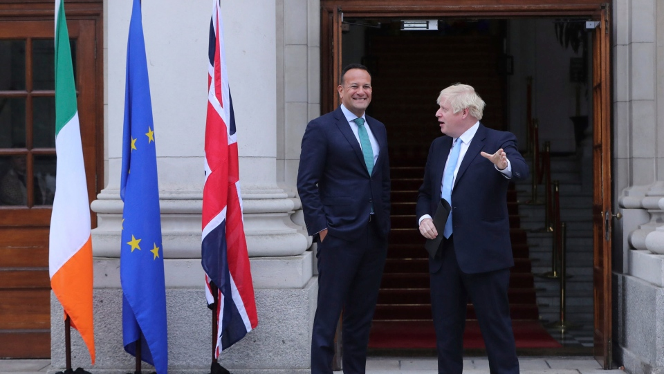 Britain's Prime Minister Boris Johnson, right, is welcomed by Ireland's Prime Minister Leo Varadkar at Government Buildings in Dublin, Monday Sept. 9, 2019. (Niall Carson/PA via AP)