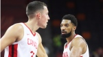 Canada's Khem Birch, right, gestures to teammate Kyle Wiltjer, left, during their group H match against Senegal in the FIBA Basketball World Cup 2019 game in Dongguan in south China's Guangdong province, on Sept. 5, 2019. (THE CANADIAN PRESS / AP)