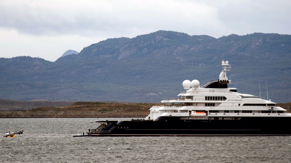 In this Monday, Jan. 31, 2011 file photo, an helicopter floats on the water close to the Octopus yacht, owned by Microsoft's co-founder Paul Allen. The superyacht is now on the market for a cool US$326 million. (AP Photo/Alejandro Madril, File)