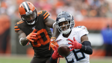 Tennessee Titans cornerback Logan Ryan (26) intercepts a throw intended for Cleveland Browns wide receiver Jarvis Landry (80) during the second half of an NFL football game Sunday, Sept. 8, 2019, in Cleveland. (AP / Ron Schwane)