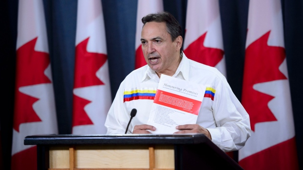 "Assembly of First Nations (AFN) National Chief Perry Bellegarde releases ""Honouring Promises: 2019 Federal Election Priorities for First Nations and Canada"" during a press conference at the National Press Theatre in Ottawa on Monday, Sept. 9, 2019. THE CANADIAN PRESS/Sean Kilpatrick"