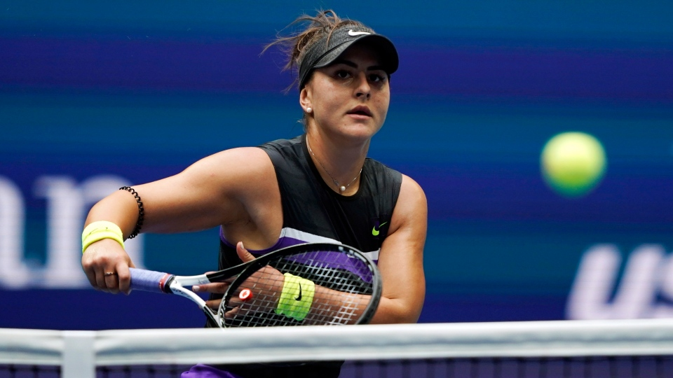 Bianca Andreescu, of Canada, returns a shot to Serena Williams, of the United States, during the women's singles final of the U.S. Open tennis championships Saturday, Sept. 7, 2019, in New York. (AP Photo/Eduardo Munoz Alvarez)