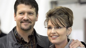 This Oct. 21, 2006 file photo shows Alaska Gov. Sarah Palin standing beside her husband, Todd Palin, in Anchorage, Alaska. (AP Photo/Al Grillo, file)
