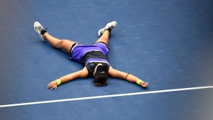 Bianca Andreescu, of Canada, lays on the court after defeating Serena Williams, of the United States, during the women's singles final of the U.S. Open tennis championships Saturday, Sept. 7, 2019, in New York.  THE CANADIAN PRESS/AP/Sarah Stier