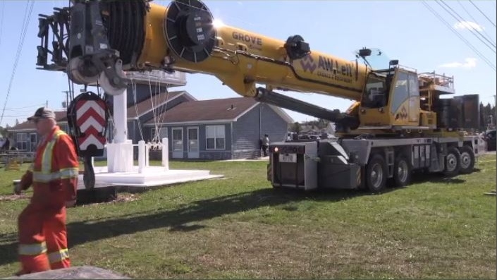 This crane was brought into the Shediac Yacht Club to help remove large boats that had been piled on top of one another by the weekend's storm.