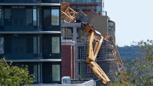 The twisted remains of a building crane hang off a construction project in Halifax on Sunday, Sept. 8, 2019. Hurricane Dorian brought wind, rain and heavy seas that knocked out power across the region, left damage to buildings and trees as well as disruption to transportation. THE CANADIAN PRESS/Andrew Vaughan