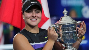 Bianca Andreescu, of Canada, poses with the championship trophy after defeating Serena Williams, of the United States, in the women's singles final of the U.S. Open tennis championships Saturday, Sept. 7, 2019, in New York. (AP / Charles Krupa)
