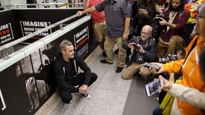 Actor Joaquin Phoenix tours a vegan ad campaign inside a subway station in Toronto, Monday, Sept. 9, 2019. THE CANADIAN PRESS/Cole Burston