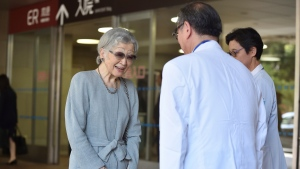 Japan's former Empress Michiko, who underwent successful surgery to remove cancer in her left breast on Sept. 8, leaves the University of Tokyo Hospital in Tokyo Tuesday, Sept. 10, 2019. (Kazuhiro Nogi/Pool Photo via AP)