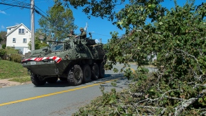 Members of the 4 Engineer Support Regiment from Camp Gagetown assist in the cleanup in Halifax on Monday, Sept. 9, 2019. THE CANADIAN PRESS/Andrew Vaughan