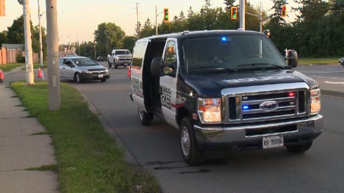 Police vehicle at scene of car crash