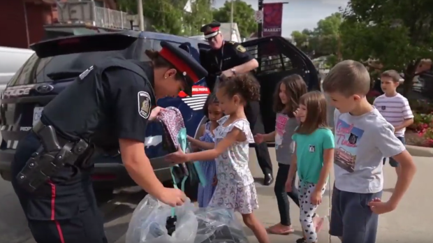 Police deliver backpacks to kids