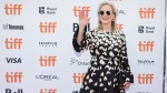 """Actor Meryl Streep waves from the red carpet of the special presentation for the film """"The Laundromat """" during the 2019 Toronto International Film Festival in Toronto on Monday, September 9, 2019. THE CANADIAN PRESS/Tijana Martin"""