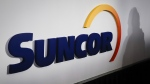 A Suncor logo is shown at the company's annual meeting in Calgary, on May 2, 2019. (Jeff McIntosh / THE CANADIAN PRESS)