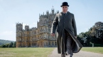 "This image released by Focus features shows Jim Carter as Mr. Carson in a scene from 'Downton Abbey.' The highly-anticipated film continuation of the ""Masterpiece"" series that wowed audiences for six seasons, will be released Sept. 13, 2019, in the United Kingdom and on Sept. 20 in the United States. (Jaap Buitendijk/Focus Features via AP)"
