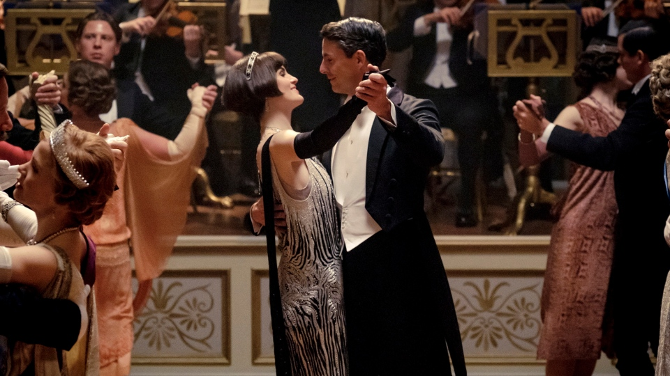 """This image released by Focus features shows Michelle Dockery as Lady Mary Talbot, centre left, and Matthew Goode as Henry Talbot in a scene from """"Downton Abbey."""" The highly-anticipated film continuation of the 'Masterpiece' series that wowed audiences for six seasons, will be released Sept. 13, 2019, in the United Kingdom and on Sept. 20 in the United States. (Jaap Buitendijk/Focus Features via AP)"""